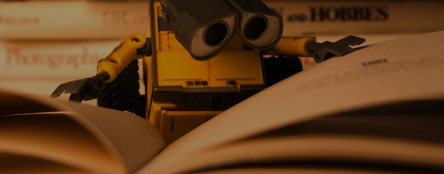 Wall-E Robot reading a book Looking for Titles